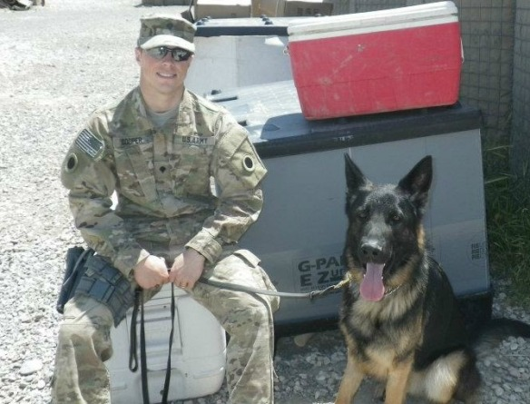 Army Spc. Devin Cooper with his MWD Panter, who developed PTSD and could not finish his next tour of duty. Spc. Cooper still does not know who adopted Panter.